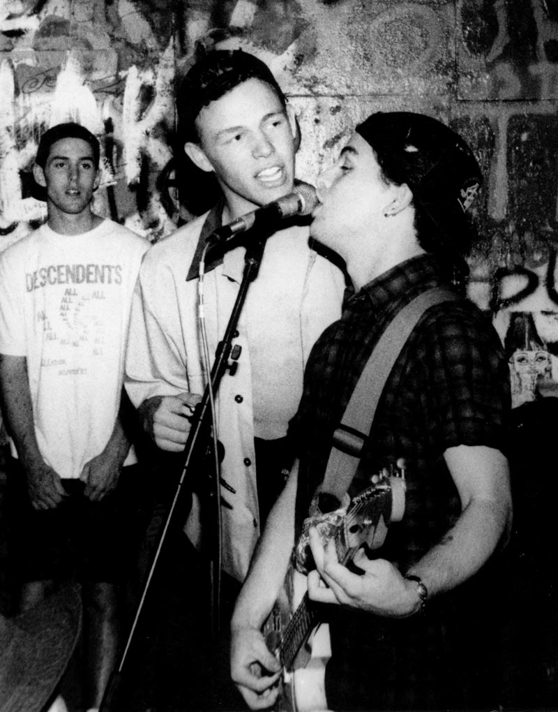 A fan sings along with Billie Joe Armstrong at 924 Gilman in the early 1990s.
