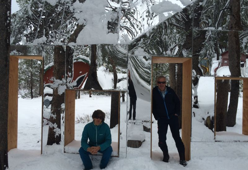 """UC Berkeley Sagehen Creek Field Station scientists Jeff Brown and Faerthen Felix. The scientists are collaborating with Newton and Helen Harrison on one part of their massive, global """"Force Majeure"""" project. Here we see them posing in front of another site-specific art project on site at Sagehen."""