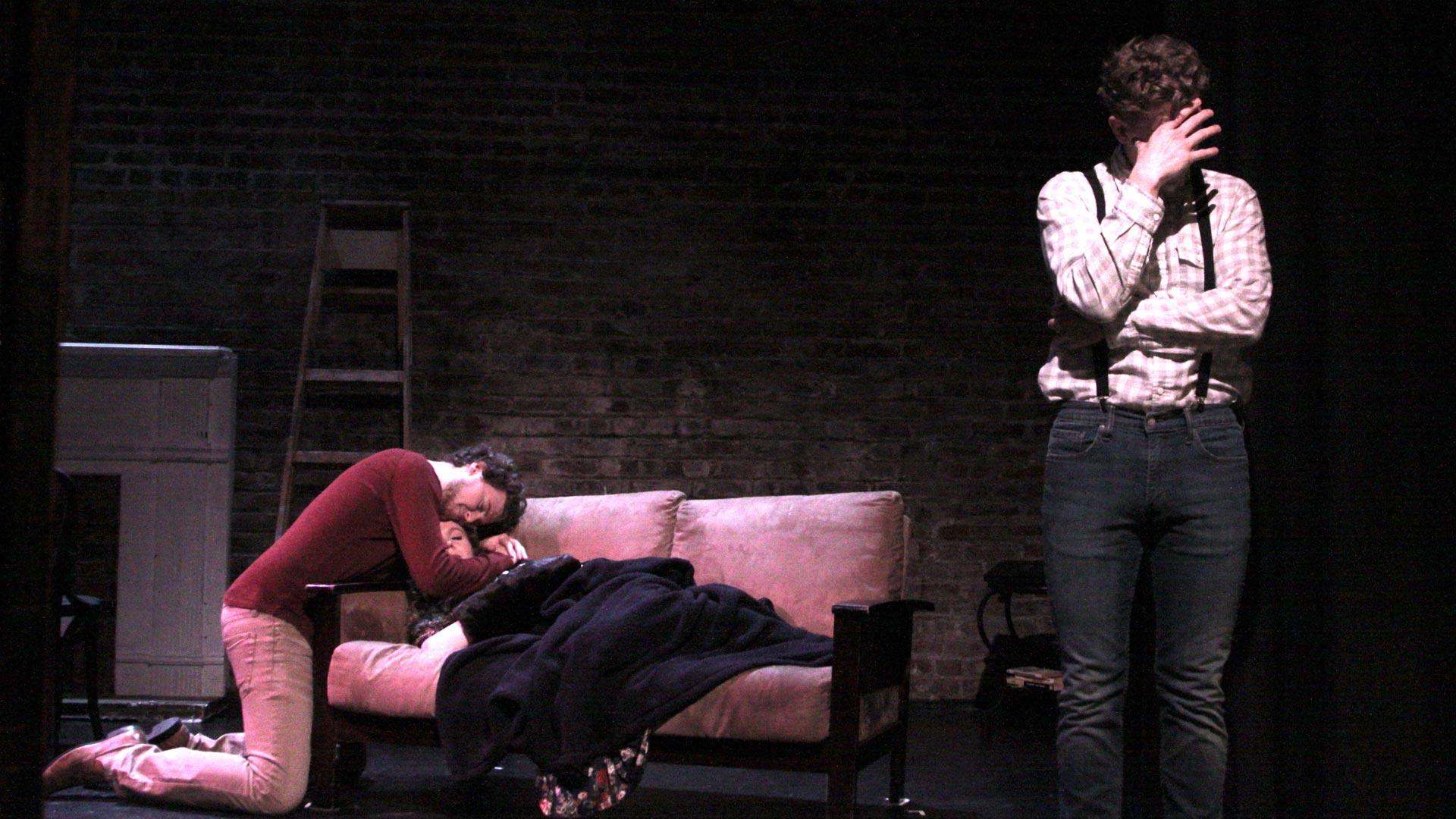 Greg Allen Friedman as Rodolfo, Morgan Harrington as Mimi and Daniel Cameron as Schaunard (L-R) in Opera on Tap's production of 'La Bohème.'