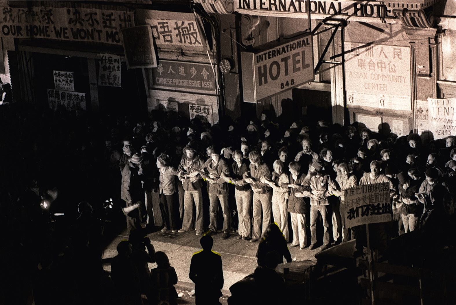 Hundreds of protesters linking arms in front of the International Hotel in San Francisco try to prevent the San Francisco Sheriffs' deputies from evicting elderly tenants on August 4,1977.