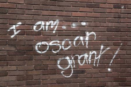 Graffiti memorializing Oscar Grant.
