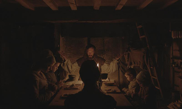 Dinner table prayer in The Witch; Courtesy A24 Films.