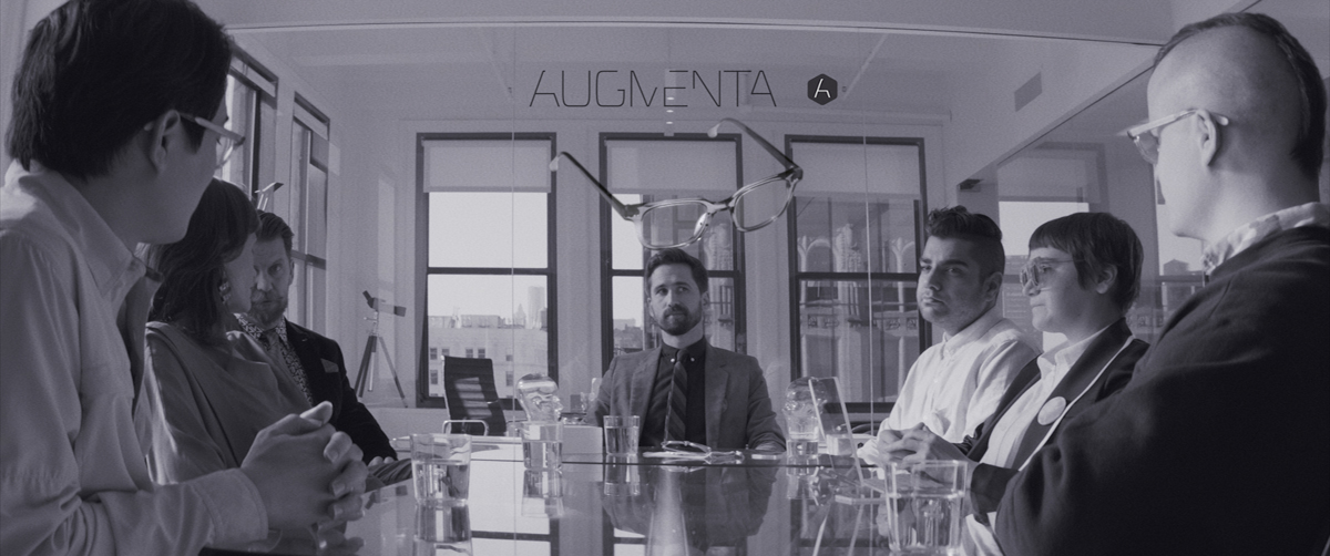 Benjamin Dickinson at center, pitching a campaign strategy to Augmenta in 'Creative Control,' a Magnolia Pictures release.