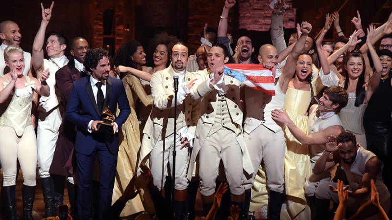 Music director Alex Lacamoire and Actor, composer Lin-Manuel Miranda celebrate on stage during 'Hamilton' GRAMMY performance