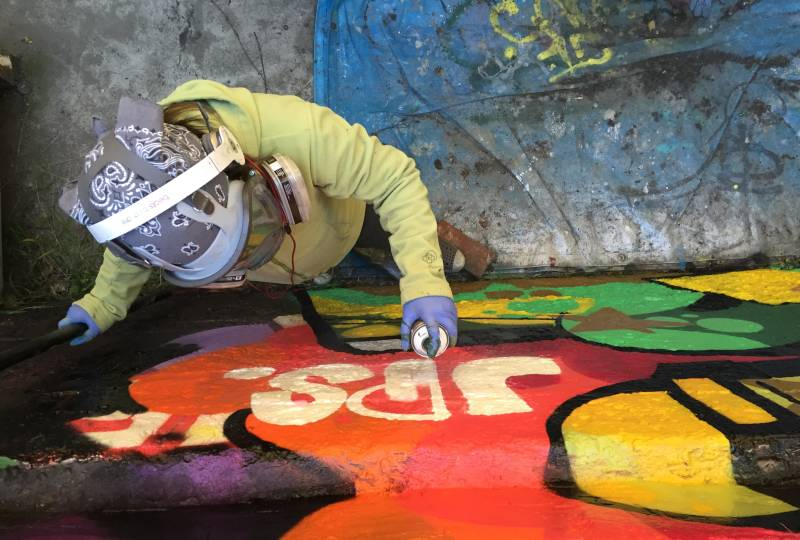 11-year-old graffiti artist Cave adorns a wall