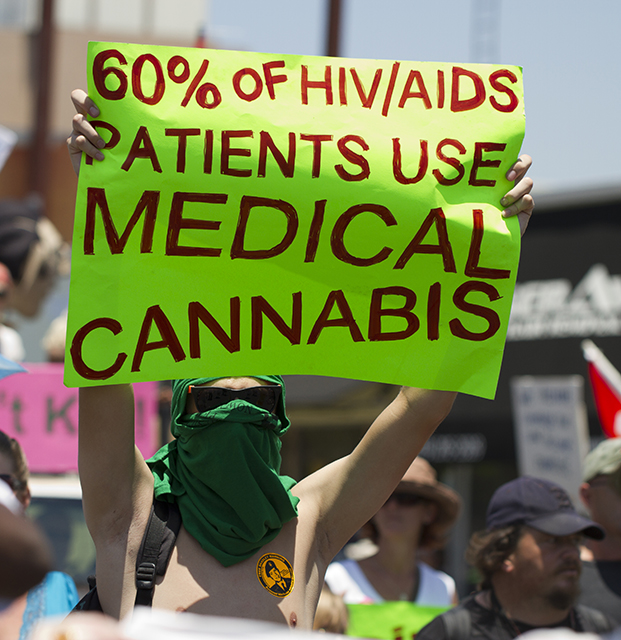 A protester holds up a sign at San Diego Gay Pride in 2012.
