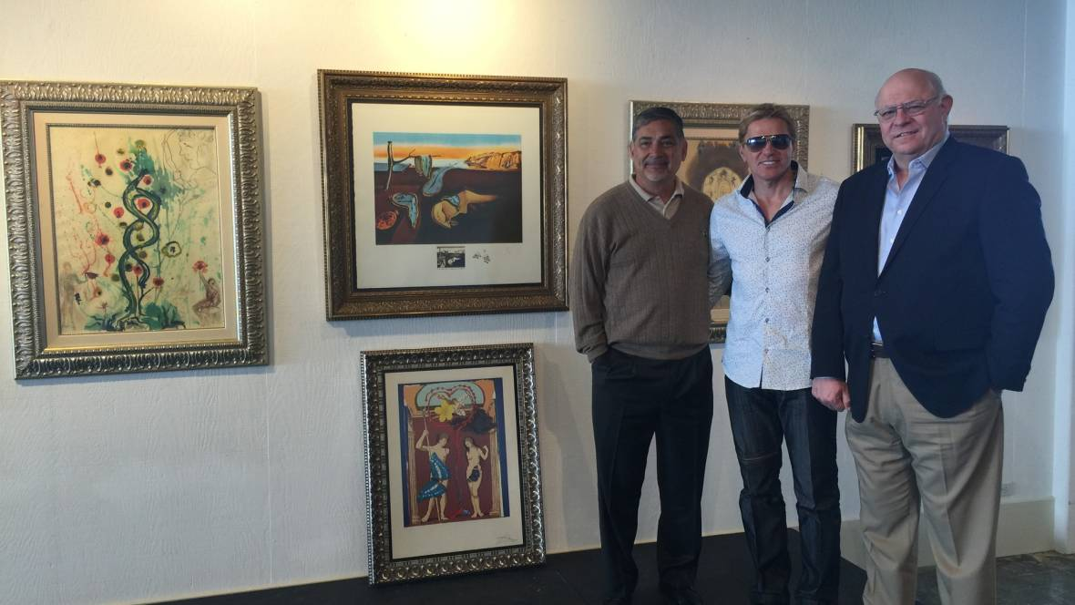 Larry Chavez (l), Dmitry Piterman (c) and Marc Del Piero (r) celebrate plans to remake the Museum of Monterey as a showcase for Piterman's extensive collection of works by Salvador Dalí.