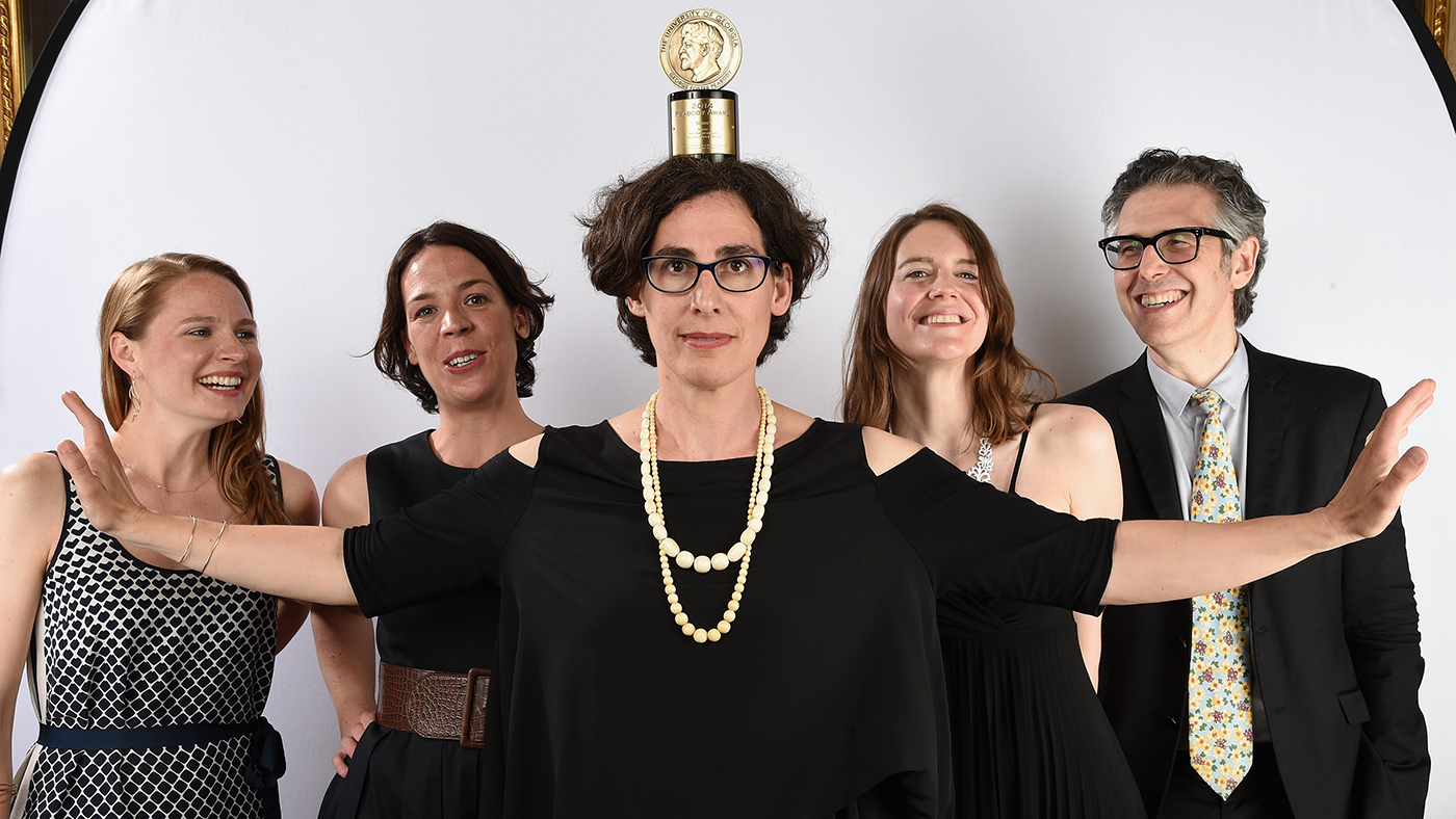 Sarah Koenig (center) poses with her award with Ira Glass (R) and guests and at The 74th Annual Peabody Awards Ceremony