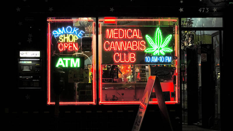 Neon signs in the window of a medical cannabis club on Haight Street in San Francisco.