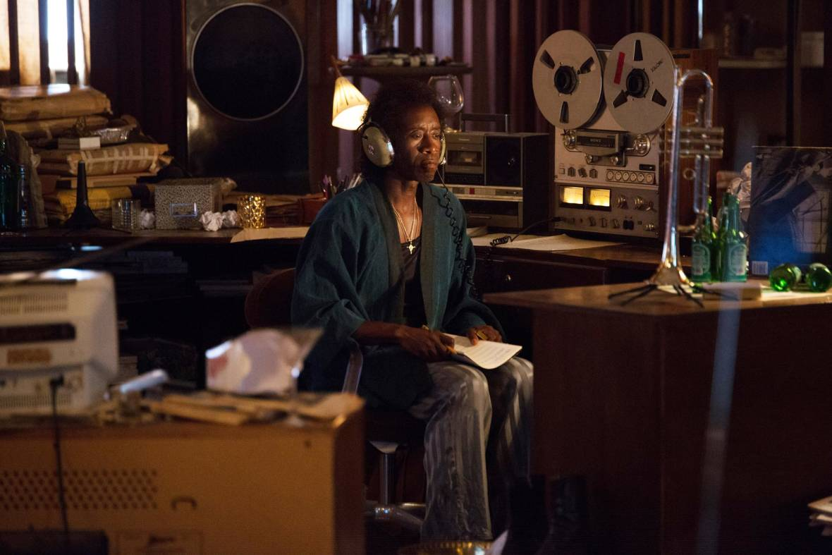 Don Cheadle as Miles Davis, listening to reel-to-reel tapes and trying to regain his muse, from 'Miles Ahead.'