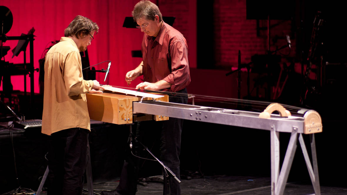 Paul Dresher and Joel Davel at the Hurdy Grande, one of Dresher's invented instruments.