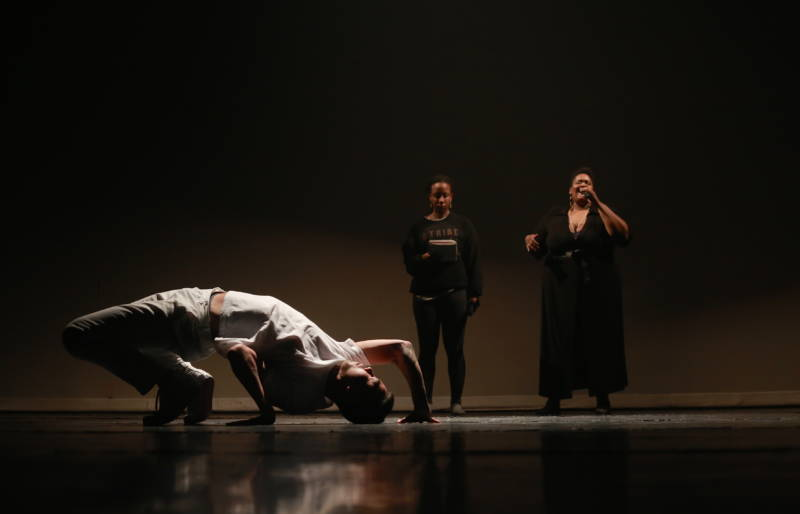 George Cheng (on the floor) with singers Rashida Chase and Valerie Troutt in Nicole Klaymoon's 'Chalk Outlines'