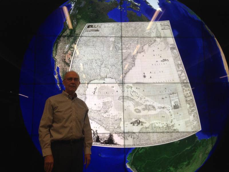 David Rumsey stands in front of a map from 1733 superimposed over Google Earth. Wouldn't you like to run a search for viewing on a 16 x 9' computer screen?