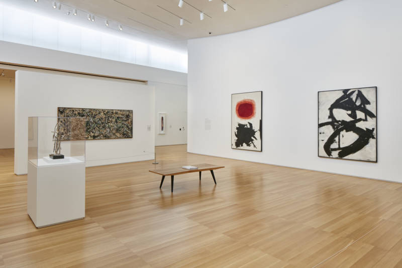 "A room at Stanford's Anderson Collection. From left to right: ""Timeless Clock,"" by David Smith (1957); ""Lucifer"" by Jackson Pollack (1947); ""Transfiguration III"" by Adolph Gottlieb (1958); and ""Figure 8"" by Franz Kline (1952)."