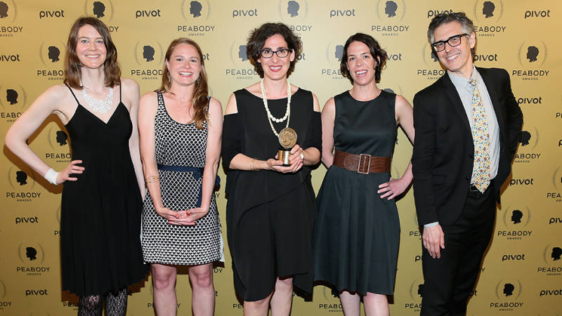 'Serial' producer Julie Snyder stands to the right of Sarah Koenig (center) as she poses with her Peabody award