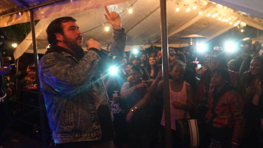 """A Trap Karaoke participant named Matthew, from Walnut Creek, performs U.G.K.'s """"International Player's Anthem"""" in Oakland on April 9, 2016."""
