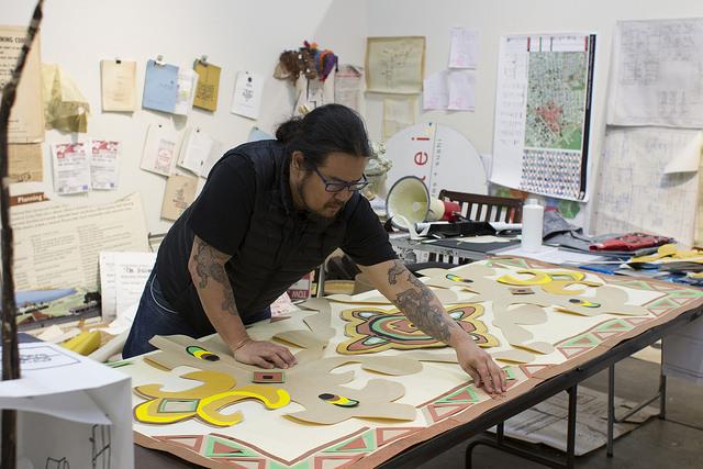 Weston Teruya at work in the Recology studios.