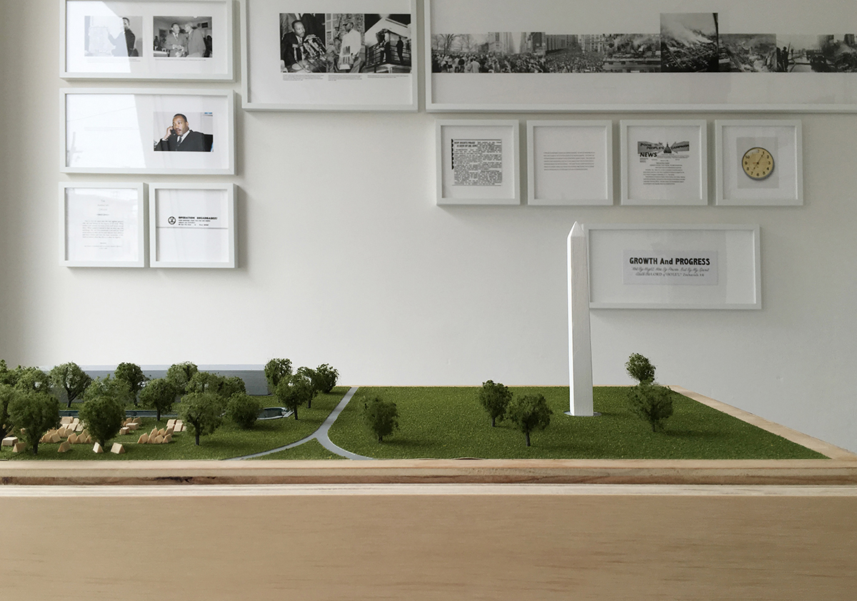 Kate Haug, Install view of 'News Today' with model of Resurrection City on the Washington Mall.