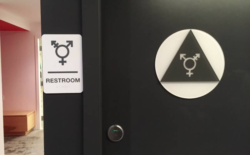 Specially ordered signs mark the unisex bathrooms at Counterpulse