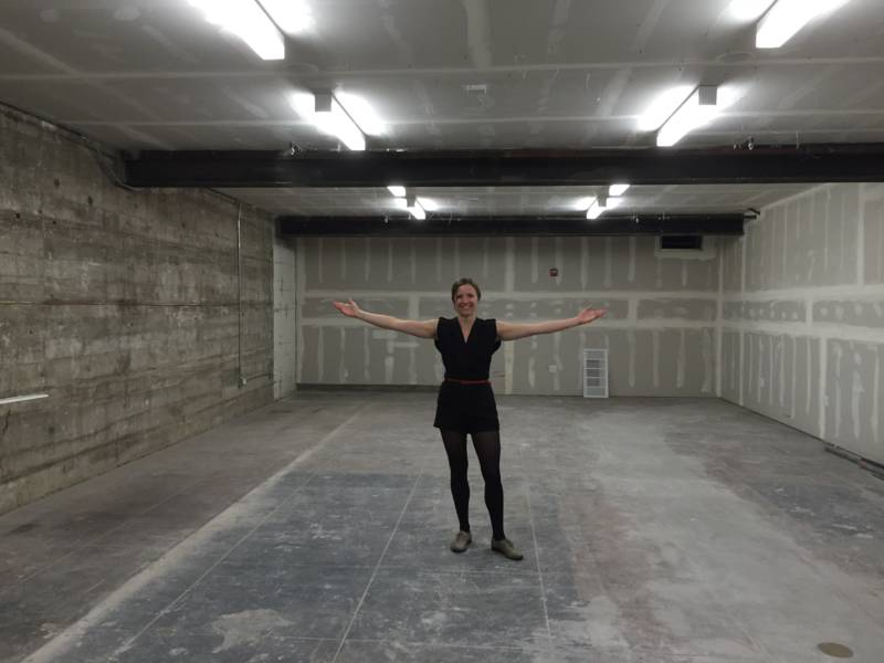 Counterpulse Artistic Director Julie Phelps beams as she shows off a new basement area which may become a rehearsal studio