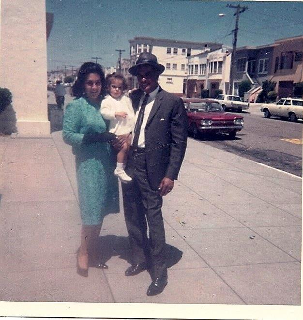 "Ivee Broussard, via Facebook: ""Once upon a time in the Excelsior District of San Francisco, people got *very* dressed up to go to Sunday mass. I love my mother's (Anita) pillbox hat, wrist length gloves, and pointy shoes, and my father's (Ivan) Sinatra look. 1968, Church of the Epiphany."""