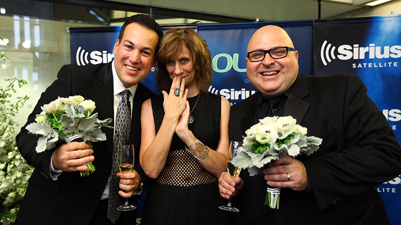 """(L-R) Jim Colucci, Lizz Winstead and Frank DeCaro at the wedding of Frank DeCaro and Jim Colucci live on air of """"The Frank DeCaro Show"""""""