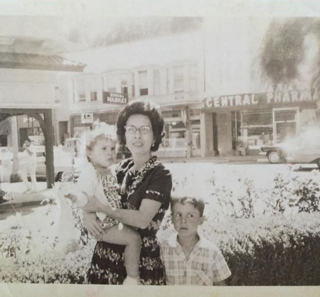 "Marisol Colon Santoni, via Facebook: ""17th Street [San Francisco] with Eureka Market in background, 1962. Pictured are my Mom and brother."""