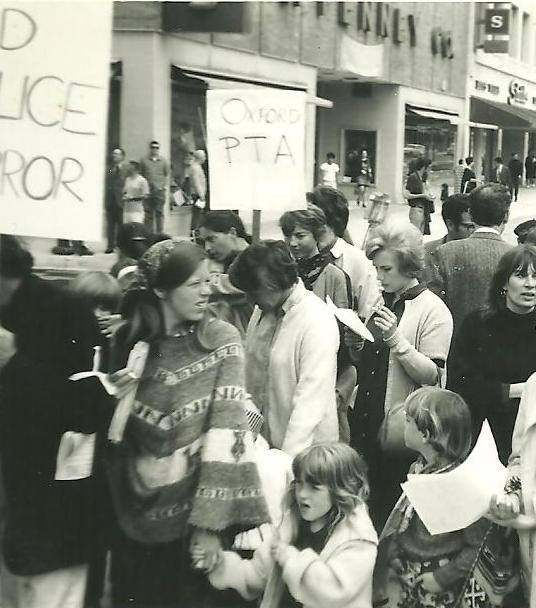 "Molly Robinson Couto, via Facebook: ""Me holding my older sister's hand during a protest march in downtown Berkeley in around 1968. My mom is just behind my sister, and her best friend is behind her next to another family friend."""