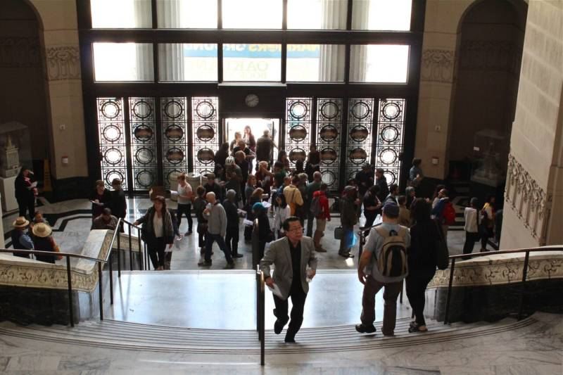 Attendees enter Oakland City Hall for the first annual Oakland Book Festival
