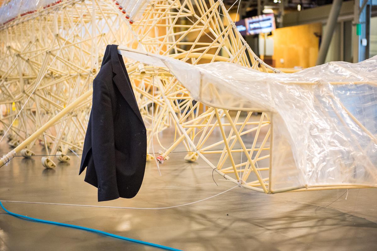 Jansen's signature suit jacket during installation at the Exploratorium.