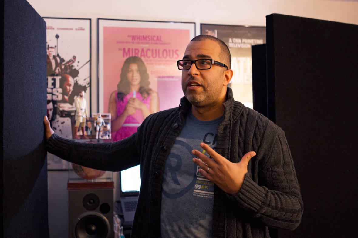 Mendez stands in his bedroom recording studio.