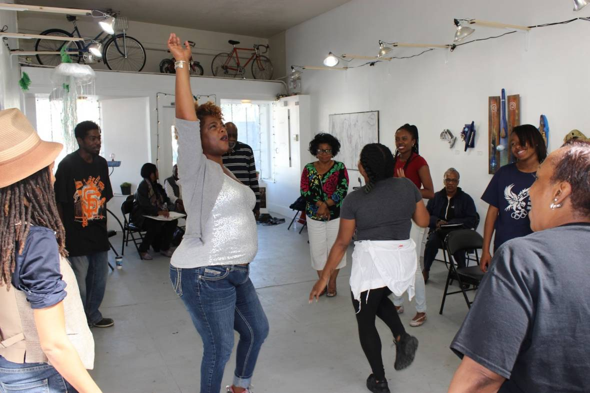 Cheri Lynn Miller and the cast of 'Crack. Rumble. Fly.: The Bayview Stories Project' warming up with an improv exercise.