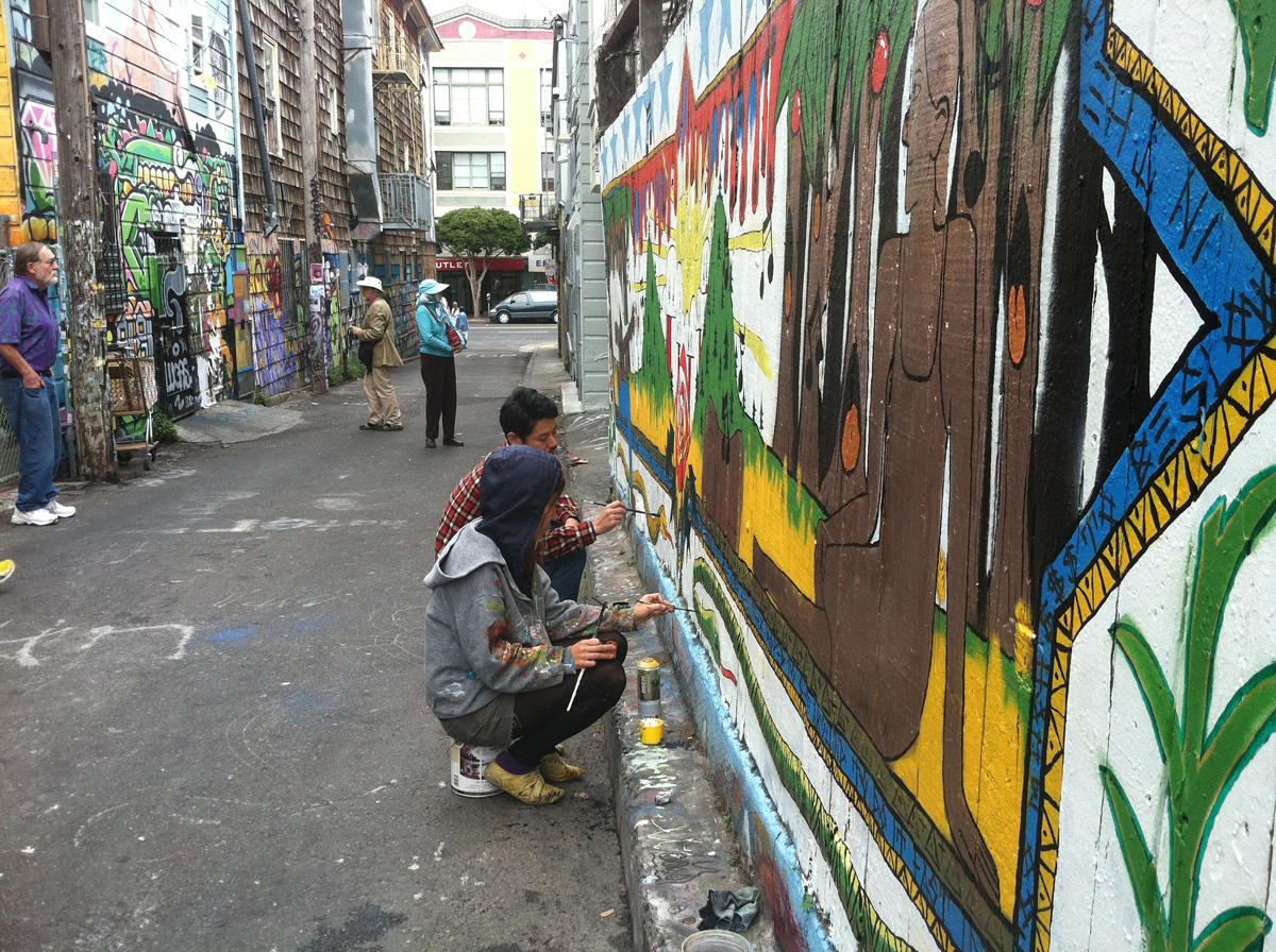 Muralists at work in Clarion Alley.