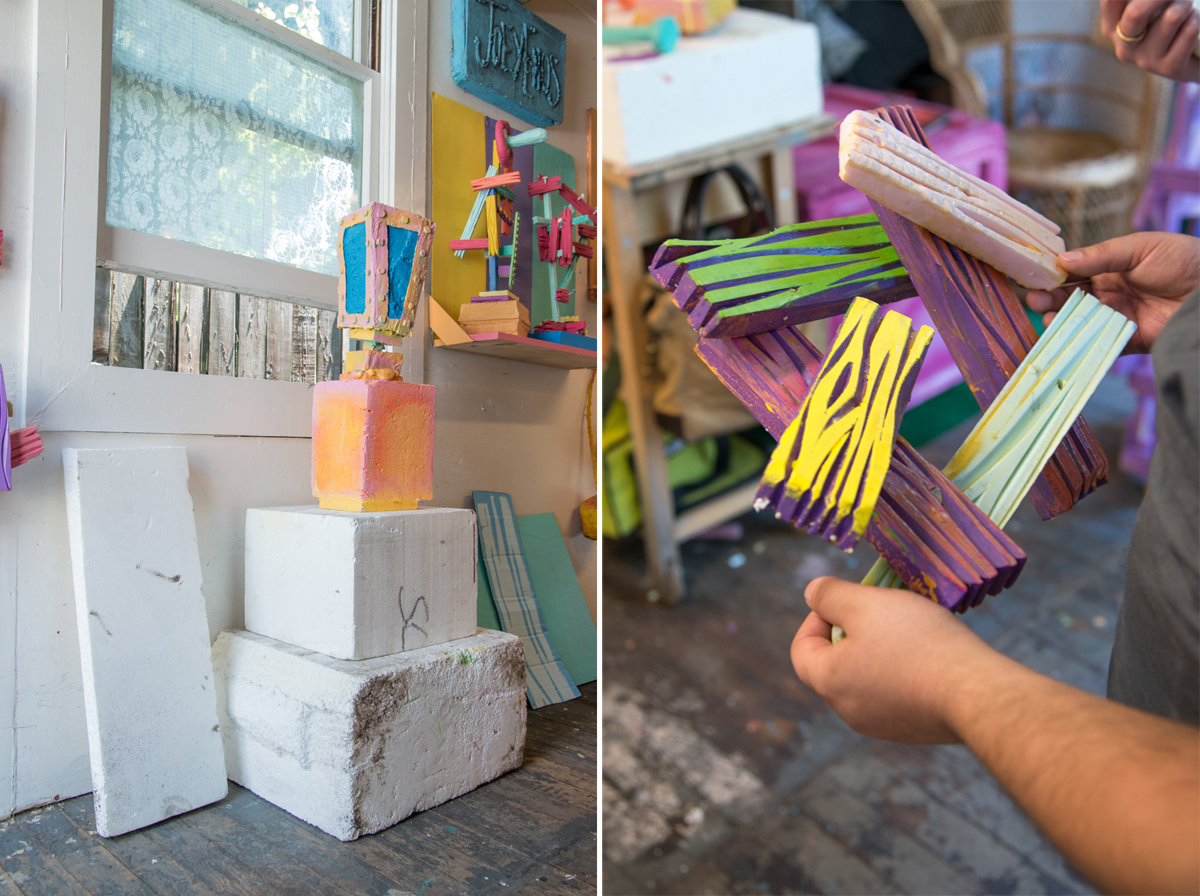 A stack of materials and a painted foam sculpture repurposed from previous works.