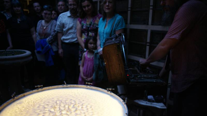 John Benson performs with his milk-covered drum at Garden of Memory in 2016.