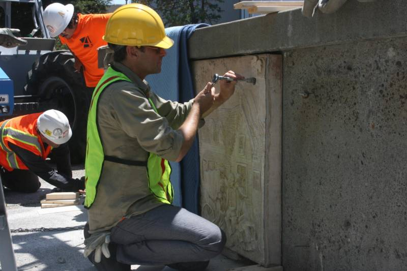 A panel by artist Ruth Asawa is removed from a fountain in Courthouse Square in Santa Rosa.