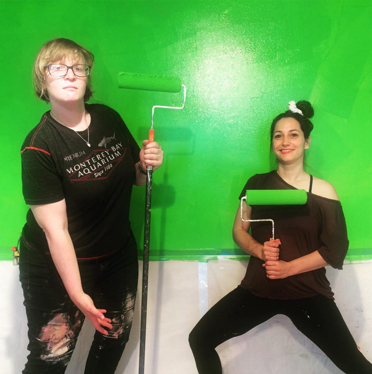 Artists Kate Rhoades and Carolyn Janssen turning a wall into a green screen at the new Royal Production Company.