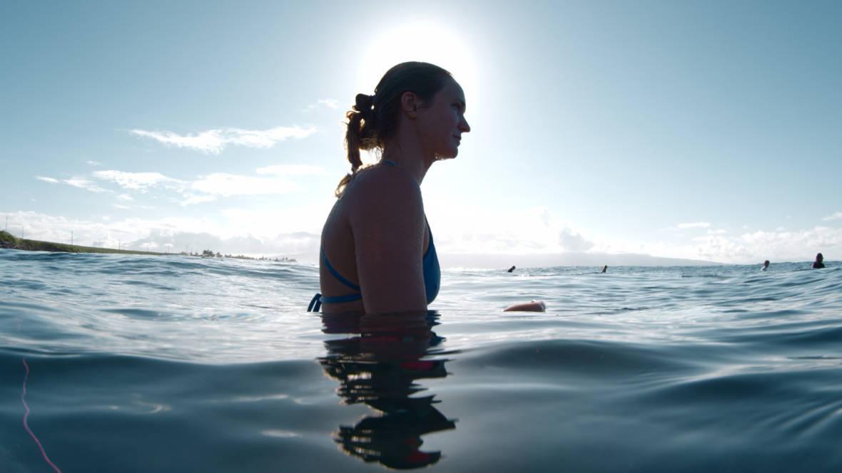 "The lure of the big wave calls men and women alike. Hawaiian surfer Paige Alms is the focus of the documentary ""The Wave I Ride."""