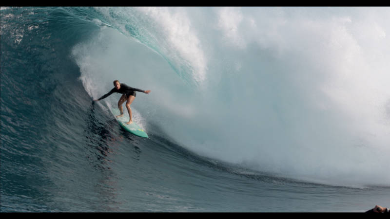 Paige Alms rides a barrel at Jaws off the coast of Maui. She was the first woman to do so.