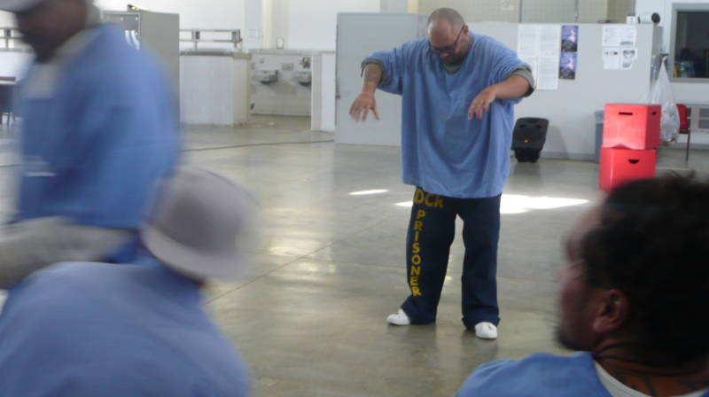 "Another inmate pretends to turn on water faucets in a game called ""Use One, Choose One."""