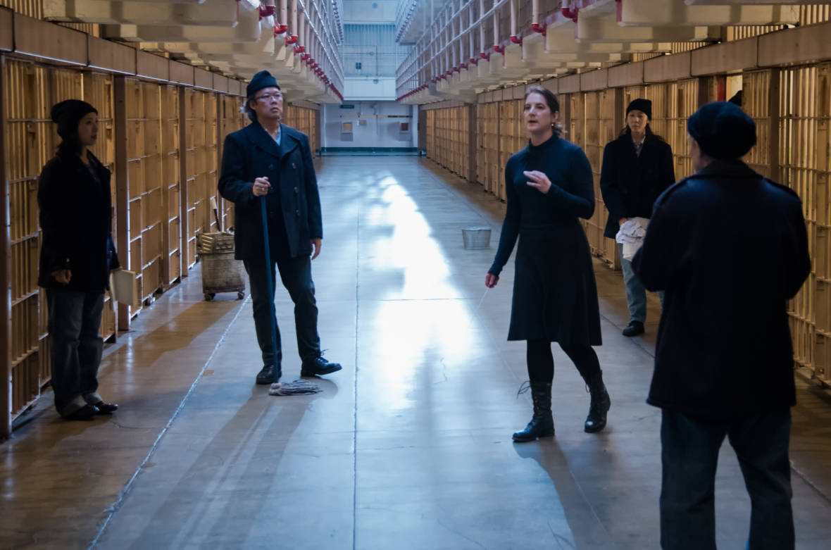 Cappella SF and composer Lisa Bielawa in a cell block on Alcatraz, the setting for Episode 9 of Bielawa's new serialized made-for-video opera, 'Vireo'