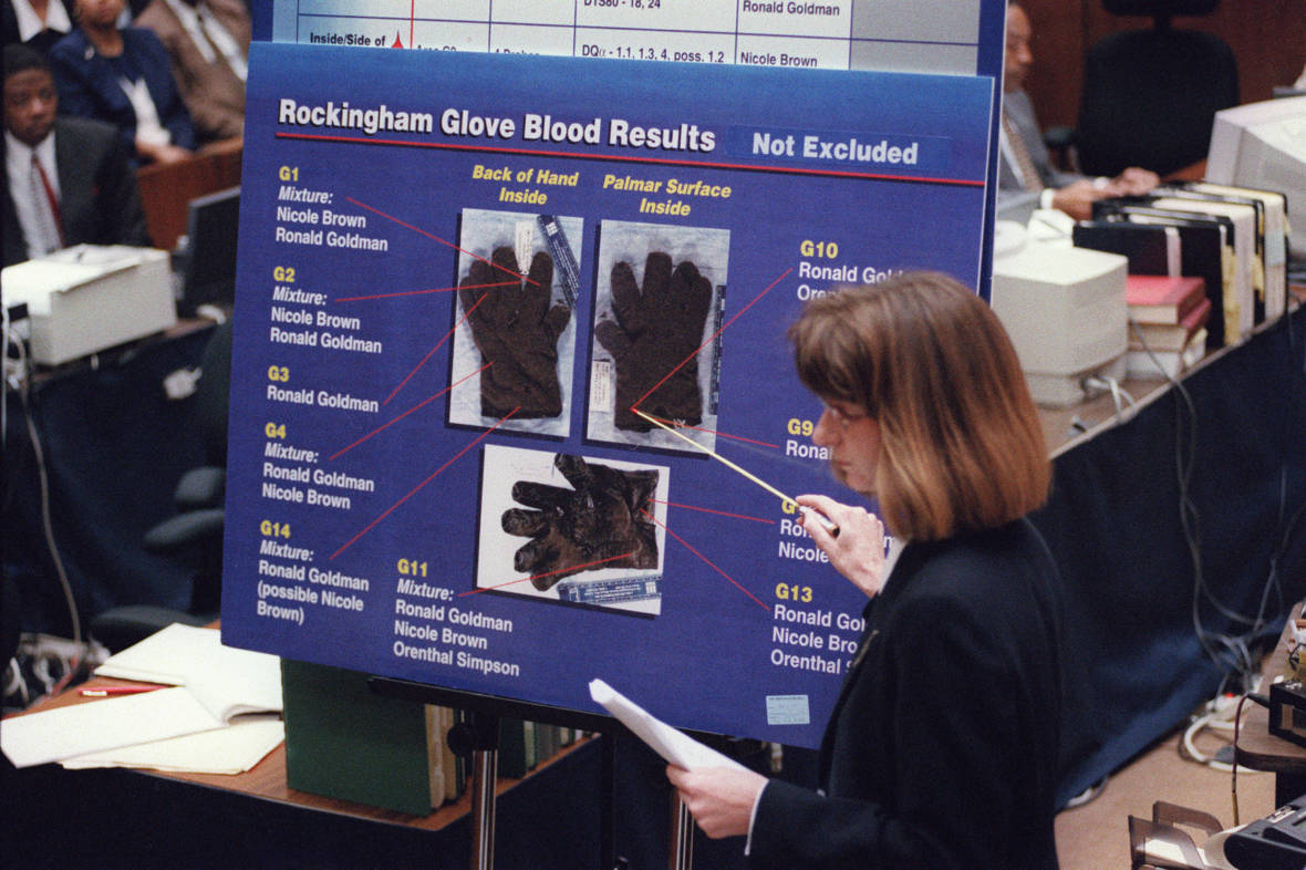 California Department Of Justice criminalist Renee Montgomery points to blood spots found on the leather glove at O. J. Simpson's Rockingham estate during redirect examination in the O.J. Simpson double-murder criminal trial on May 24, 1995, in Los Angeles.