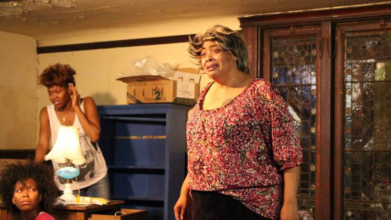 (L to R) Cookie (Chaz Shermil) watches as her mother Crank (Jasmine Hughes) and great-grandmother Big Mama (Kimba Daniels) implode in Ubunta Theater Projects' 'Hurt Village.'