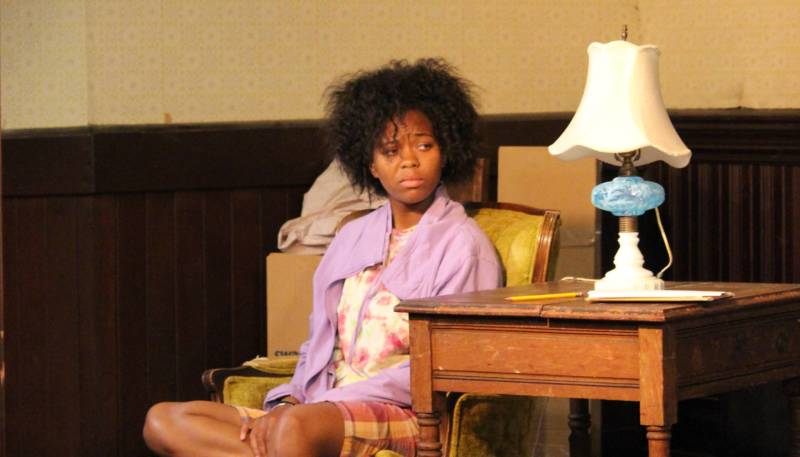 Cookie (Chaz Shermil) tries to understand the chaos around her in Unbuntu Theater Project's 'Hurt Village.'