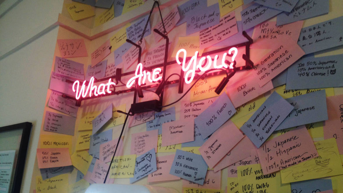 "Ruth Ozeki's installation features a neon sign saying ""What Are You?"" at the Japanese American Museum of San Jose."