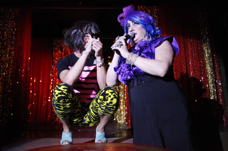 "Hosts of the Stud's ""Meow Mix"" variety show, Ultra (left) and Ferosha (right) perform on stage , July 2016"