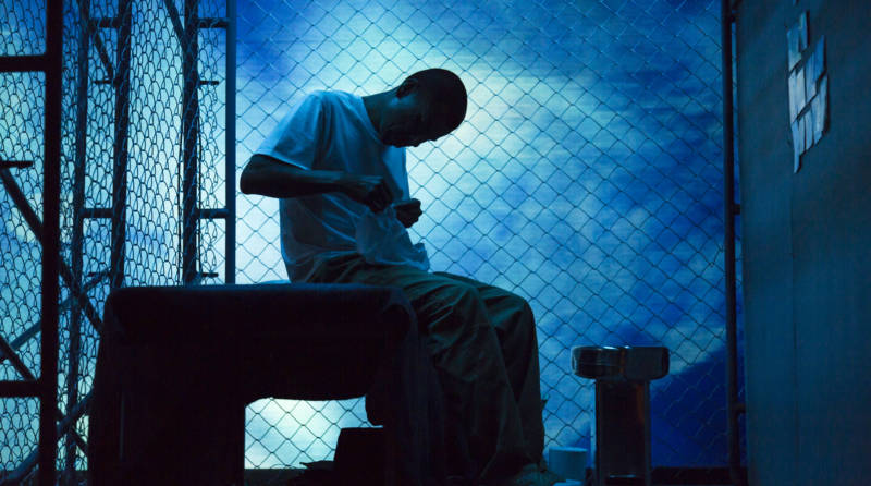 The stage goes blue around the distraught Victor Santiago (Carlos Aguirre) in 'The Box' at Z Space.