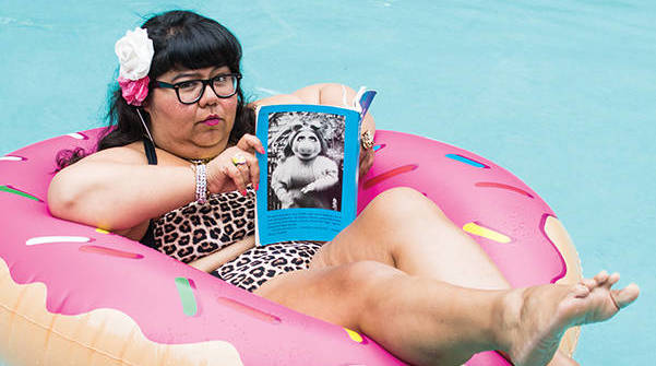Author and activist Virgie Tovar relaxes in a swimming pool