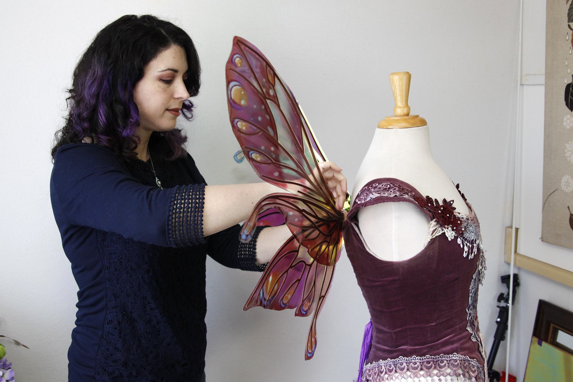 Professional fairy wing maker Angela Jarman adjusts one of her handmade wings at her studio in Richmond.