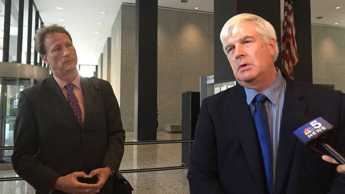 Attorney William Zieske (left) and his client Robert Fletcher (right) speak to reporters at the US federal courthouse in Chicago on August 23, 2016, after losing their lawsuit against artist Peter Doig.  They accused him of falsely denying authorship of a painting.